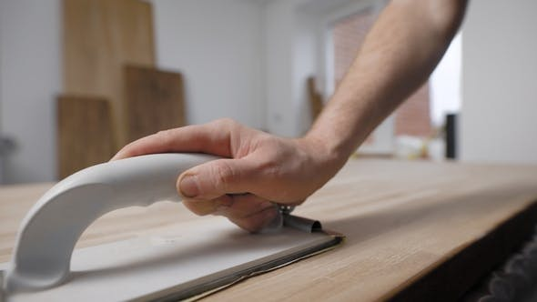 Thumbnail for Shot of a Handyman Sanding a Piece of Wood.