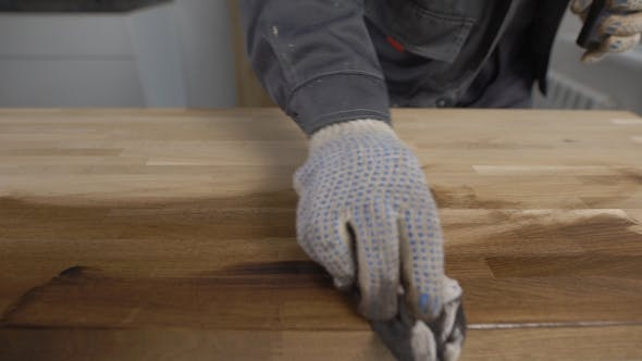 Thumbnail for Man Wearing Protection Gloves Working with a Wood.