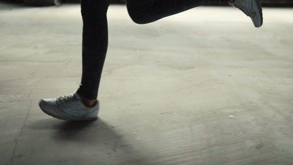 Woman Jogs Indoors