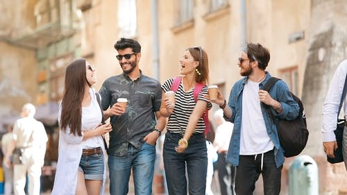 Young People Stroll with Coffee