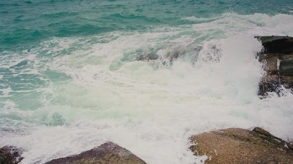 Thumbnail for Waves Break on the Shore and Rocks