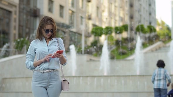 Thumbnail for Elegance Woman Using Phone at Fountain Background