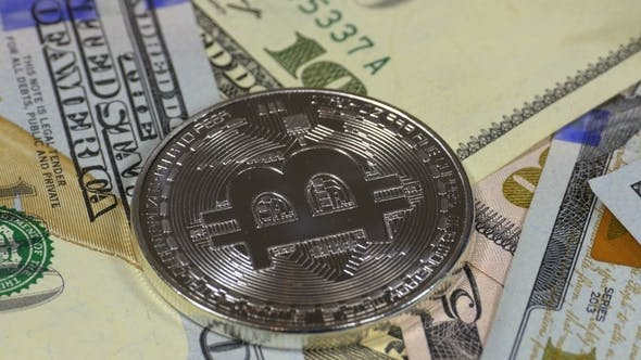 Thumbnail for Silver Bitcoin Coin BTC and Bills of Dollars Are Rotating
