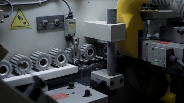 Thumbnail for Gears Rotating in a Edge Banding Machine.