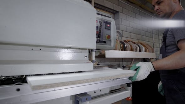 Thumbnail for Industrial Carpenter Working on Edge Banding Machine on the Factory.