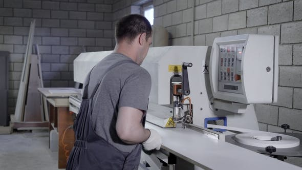 Thumbnail for Carpenter Operating on a Modern Edge Banding Machine on the Factory.