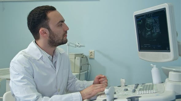 Thumbnail for Young Doctor with Ultrasound Diagnostic Machine