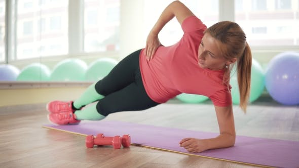 Cover Image for The Girl Is Doing Exercises for the Waist