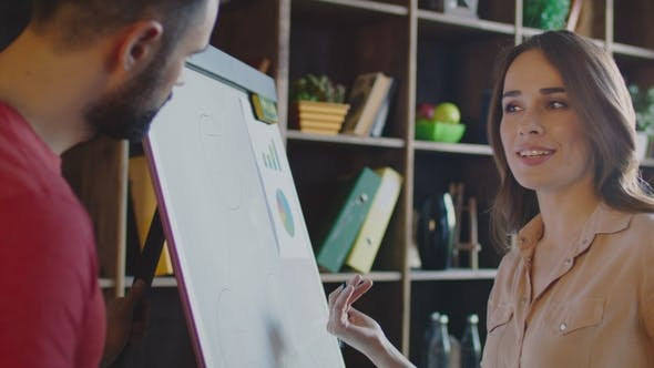 Thumbnail for Smiling Woman Explaining Business Strategy on Planning Board. Business Meeting