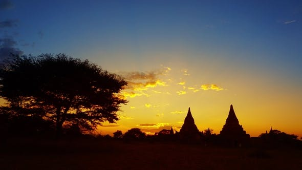 Cover Image for Silhouette of Temples and Tree in Bagan at Sunset