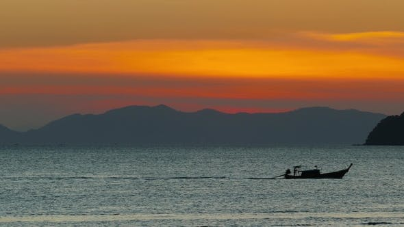 Thumbnail for Long Tail Boats in the Sea at Sunset