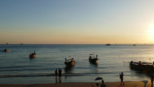 Cover Image for Long Tail Boats on Ao Nang Beach at Sunset