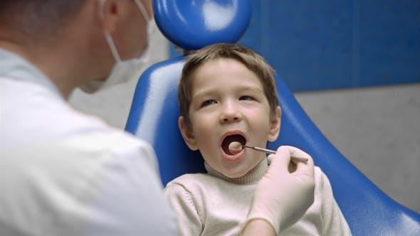 Thumbnail for Little Boy Visiting the Dentist