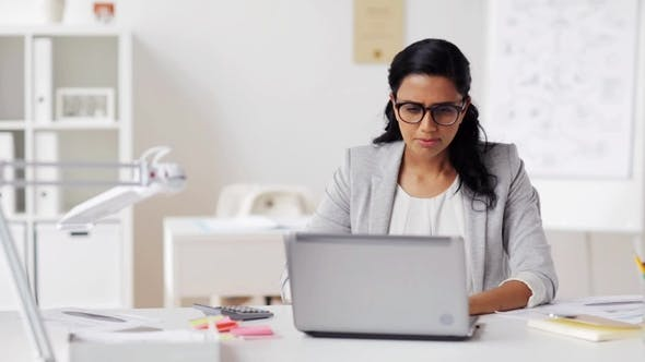 Thumbnail for Stressed Businesswoman with Laptop at Office