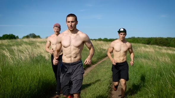 Thumbnail for Three Athletic Shirtless Men Jogging in Nature Under Hot Sun.
