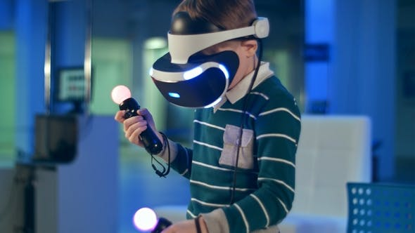 Thumbnail for Little Boy in Virtual Reality Headset Holding Move Motion Controllers