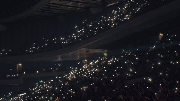 Thumbnail for Crowded Concert Hall, People with Lights in the Darkness