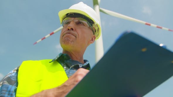 Thumbnail for Engineer Writing On Clipboard While Doing Wind Turbine Inspection