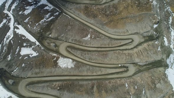 Thumbnail for Trucks Go on High Mountain Road Pass. Aerial Vertical Top-Down View