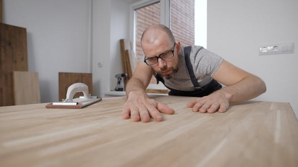 Thumbnail for Master Is Checking Smoothness of Polished Surface of Wooden Boards, Stroking It By Hands and