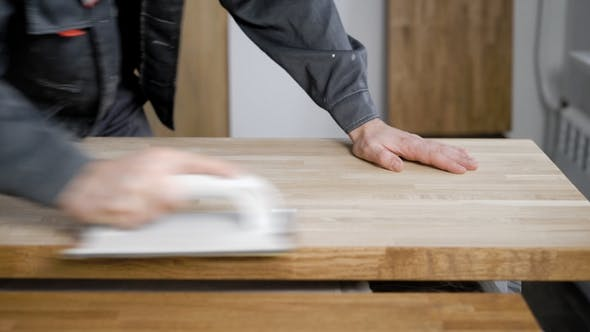 Thumbnail for Carpenter Is Processing Timber Planks, Grinding By Abrasive Paper, Rubbing It Over Surface,  of Hand