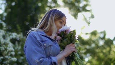 Woman in Denim Jacket Smell Bouquet of Peonies