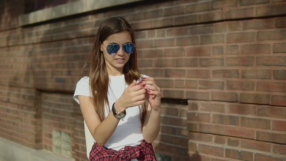 Thumbnail for Focused Young Girl Holding an Old Compass in Hand To Looking for Right Way