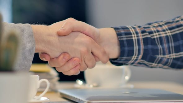 Thumbnail for Men Shaking Hands at the Meeting