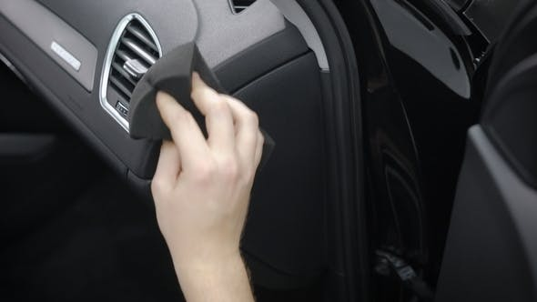 Thumbnail for Man Is Cleaning Control Panel Inside a Car, Rubbing It By Soft Cloth, Removing Dust and Dirt