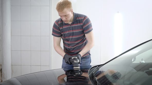 Thumbnail for Redhead Male Worker Is Processing Surface of Car By Polishing Machine in a Car-service, Covering By