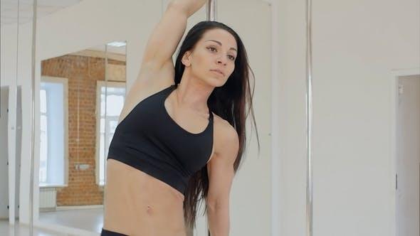 Thumbnail for Beautiful Slim Girl with Pylon in Studio