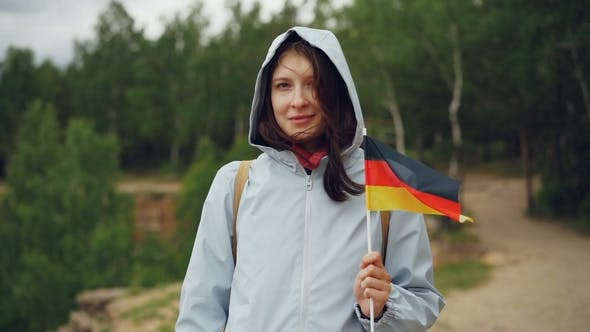 Portrait of German Woman Holding Flag of Germany