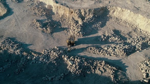 Thumbnail for Drone Aerial Footage. Fly Around Excavator in a Mountain Stone Quarry