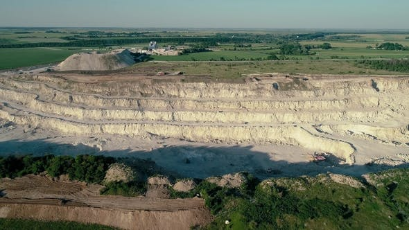 Thumbnail for Drone Aerial Footage. Fly Over a Mountain Stone Quarry. Dolly Shot