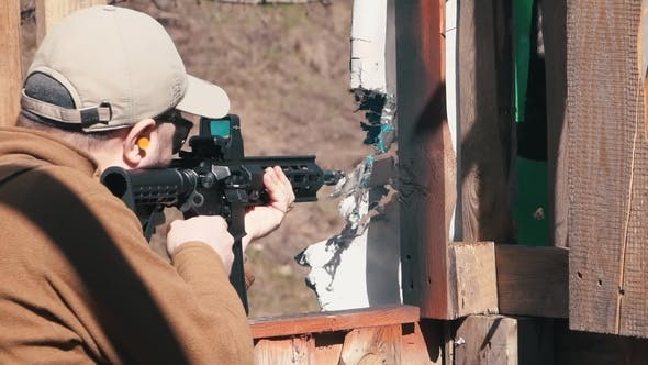 Thumbnail for Footage. Man Firing Shoots a Carbine in Training Killhouse