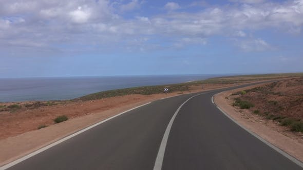 Thumbnail for View From Car Driving on Road Along Atlantic Coast