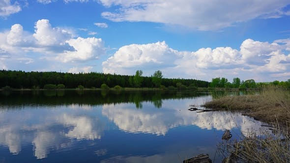 Thumbnail for Clouds Are Reflected in Smooth Water of Lake