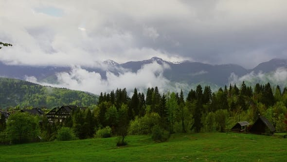 Thumbnail for Alps Landscape with House and Trees in Fog Clouds