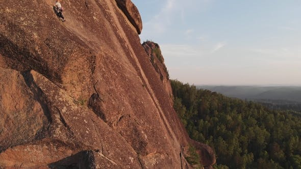 Thumbnail for Aerial View of the People Climb To the Top of the Rock in the Siberian Nature Reserve Stolby