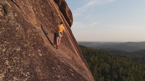 Aerial View of the People Climb To the Top of the Rock in the Siberian Nature Reserve Stolby.
