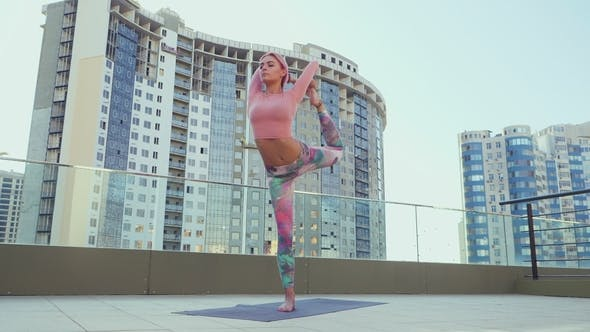 Thumbnail for Slim Healthy Girl with Pink Dyed Hair Doing Yoga Practice and Pilates Exercises on the Roof Top of