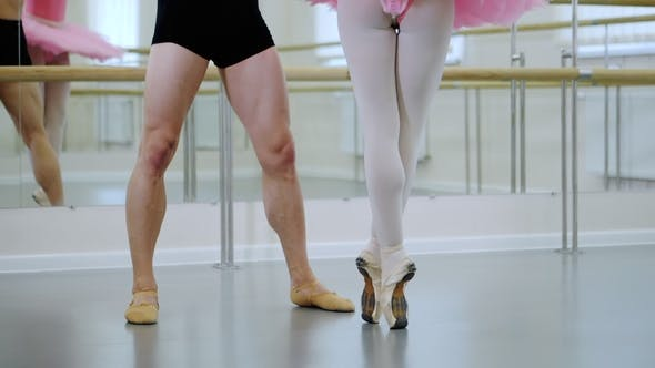 Cover Image for Legs . Rehearsal in the Ballet Hall or Studio with Minimalism Interior. Young Professional Sensual