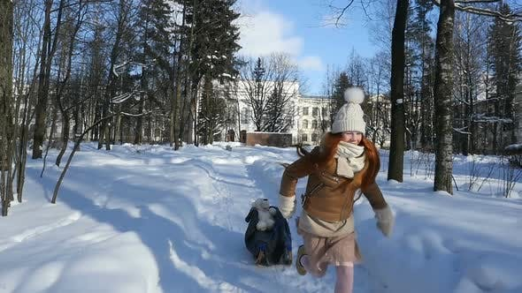 Child Teenage Sledding, Red-Haired Kid Walking at Sunny Winter Day