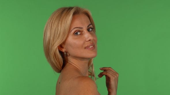 Thumbnail for Sexy Mature Beautiful Woman Smiling Seductively To the Camera