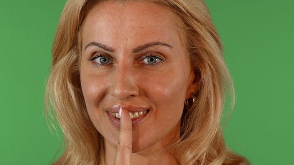 Thumbnail for Stunning Mature Woman Shushing To the Camera Asking for Silence
