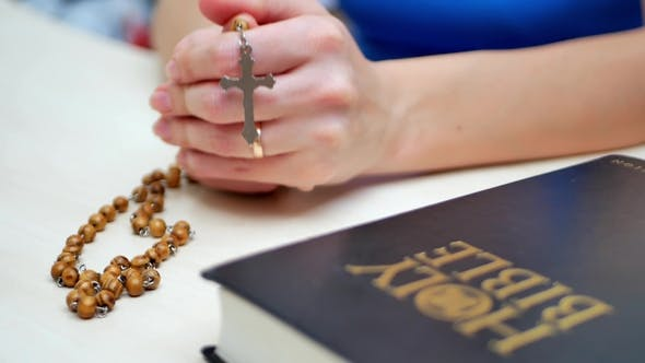 Thumbnail for Woman Prays with Holy Bible