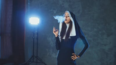 Beautiful Catholic Nun Smokes. Rotten Religion