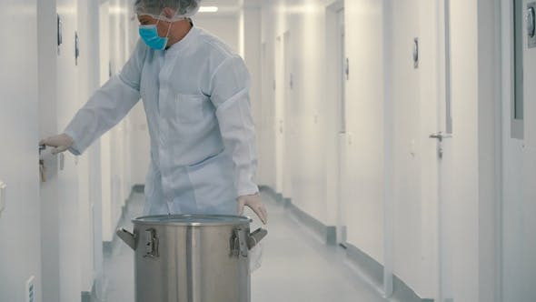 Thumbnail for Chemist Carries Instruments in Metallic Barrel for Sterilization