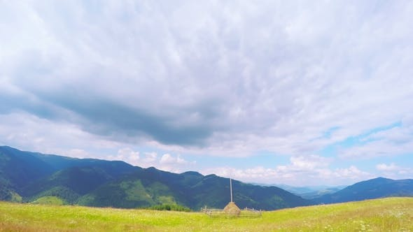 Thumbnail for Summer Mountains Landscape with Haystack and Clouds