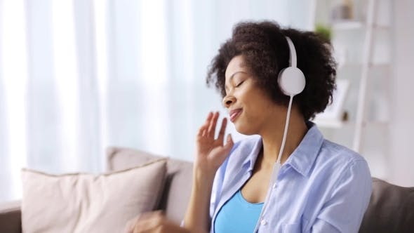 Thumbnail for Woman with Headphones Listening To Music at Home